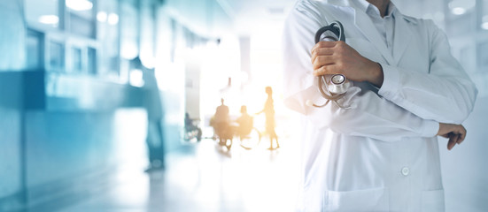Healthcare and medical concept. Medicine doctor with stethoscope in hand and Patients come to the hospital background.