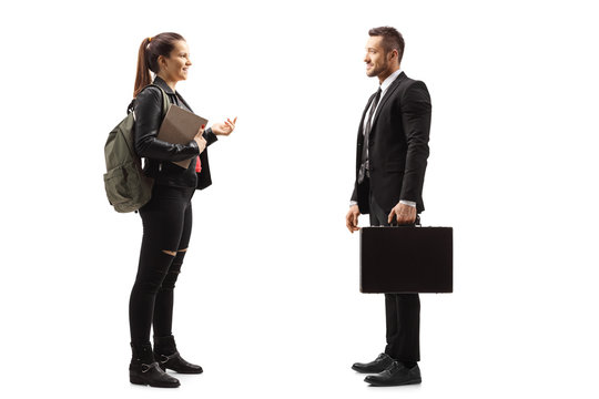 Female student talking to a man in a suit with a briefcase