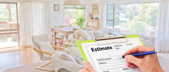 Banner Builder Hand writing estimate on a clipboard to renovate a house interior