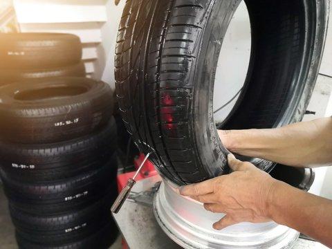 Tire patch, Car service, Tyre repair. Mechanic repair of tire.