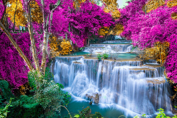Poster Cascades Amazing in nature, beautiful waterfall at colorful autumn forest in fall season