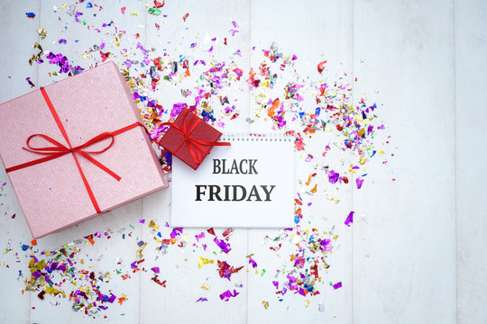 Concept sales, black Friday, discount with tag, some prize and flower on a wooden background Copyspace. Flat Layout