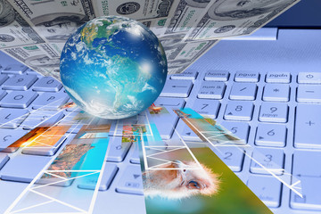 "Stock photography concept - Glass globe on the computer keyboard with photo and dollars ""Elements of this image furnished by NASA """