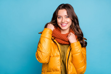 Closeup photo of amazing millennial lady easy-going person holding knitted scarf wear modern stylish autumn windbreaker isolated blue color background
