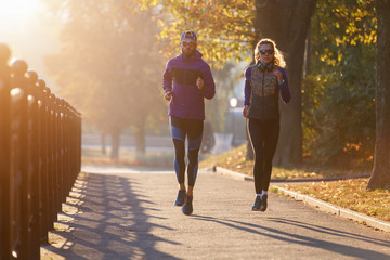 Fitness couple running in the town in the morning