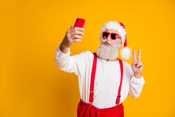 Portrait of funky grey white hair santa claus in red hat cap enjoy x-mas christmas time take selfie...