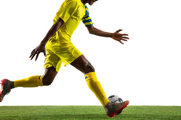 Professional african-american football or soccer player of yellow team in motion isolated on white...