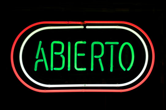 ABIERTO sign (the Spanish word for OPEN) in red, white, and green neon