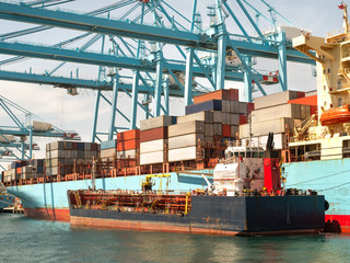 Container ship in the habour loading and unloading containers
