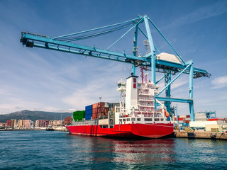 Container ship in the port of Algeciras, Spain loading and unloading containers