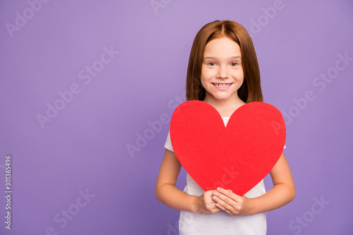 Happy mother's day. Photo of pretty little foxy lady hold large red paper heart figure greeting mother holiday present surprise wear white t-shirt isolated purple background