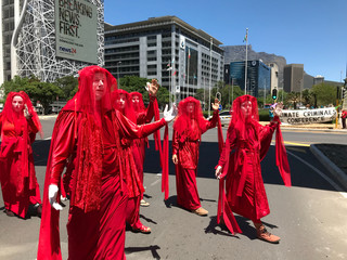 Protestors from climate change awareness collective Extinction Rebellion demonstrate outside the annual Africa Oil Week conference in Cape Town