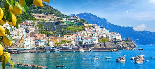 Poster Coast Panoramic view of beautiful Amalfi on hills leading down to coast, Campania, Italy. Amalfi coast is most popular travel and holiday destination in Europe.