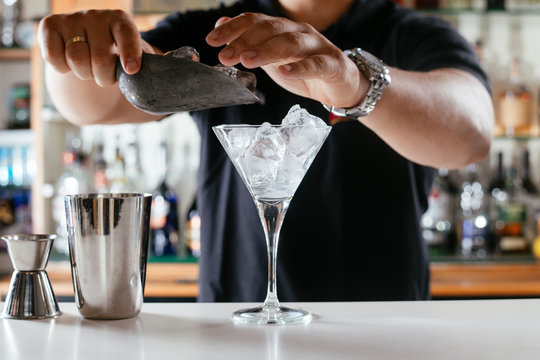 Barman making cocktail on bar counter