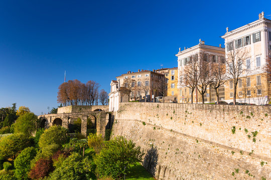 Beautiful Porta San Giacomo gate and the city walls of Citta Alta old town in Bergamo, Italy