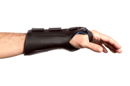 human hand with a wrist brace, orthopedic equipment isolated on white background with clipping path and copy space for your text