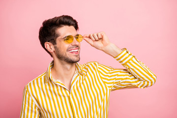 Closeup photo of amazing macho guy good mood looking empty space summer sunny day wear sun specs stylish striped shirt isolated pink color background Wall mural