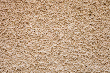 Texture beige pebble dash stucco house facade