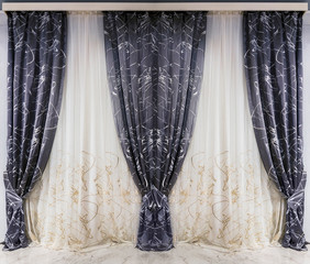 Dark gray curtains and white tulle with abstract ornament