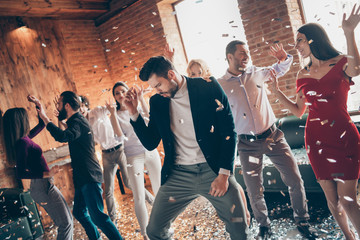 Photo group of friends gathering dance floor x-mas students party amazing mood dancing together wear formalwear dress shirts jacket luxury restaurant indoors