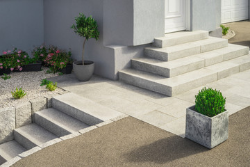 Modern granite external staircases and entrance to a single-family home