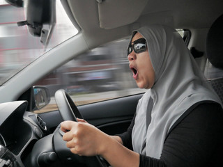 Temperamental Driver Concept, Angry Woman in Traffic Jam