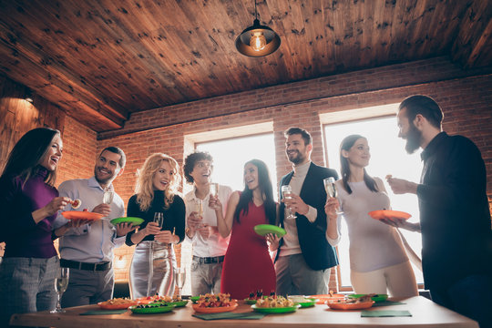 Portrait of nice attractive smart lovely cheerful cheery glad guys colleagues celebrating birthday spending festive tradition at modern industrial brick wood loft style interior office house indoors