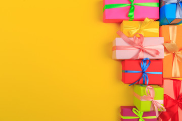 Different colored gift box on color background. Top view of various present boxes on minimal background. Birthday, Christmas, wedding, valentine, romantic gifts - Image