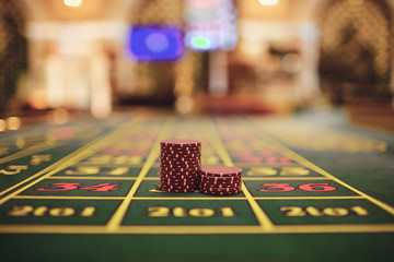Roulette chips on a gaming table in a casino.