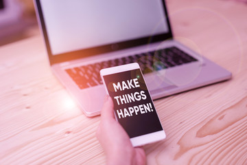 Conceptual hand writing showing Make Things Happen. Concept meaning you will have to make hard efforts in order to achieve it woman with laptop smartphone and office supplies technology