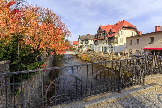 Polanica - Zdroj, polish spa in Silesia. Promenada along banks of Bystrzyca Dusznicka River in center of spa
