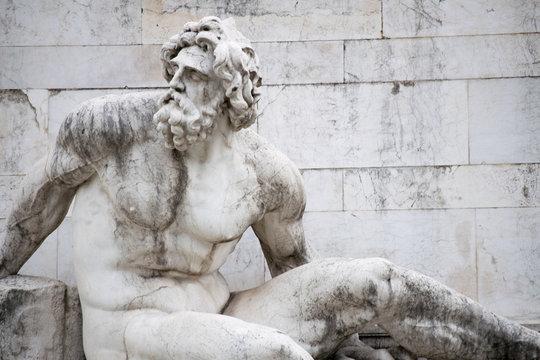 statue on a fountain in piazza venezia rome italy
