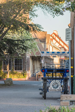 Solvang, USA - February 13, 2016: Surrey bike for carrying tourists in the park of Danish style city