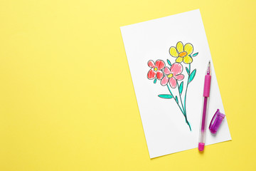 Top view of greeting card with drawn flowers and pen on yellow background, space for text. Happy Mother's day
