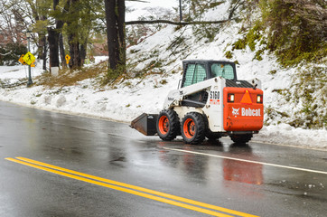 Bobcat snow removal truck on road in winter