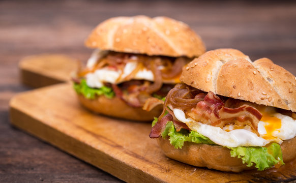 Bacon and egg sandwiches with onions and lettuce