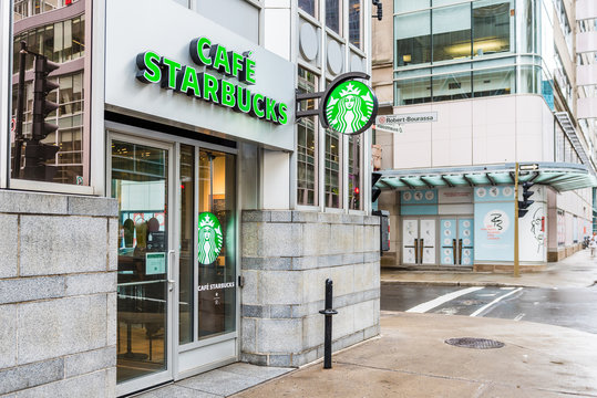 Montreal, Canada - May 26, 2017: Cafe Starbucks sign and Robert Bourassa street in downtown area of city in Quebec region