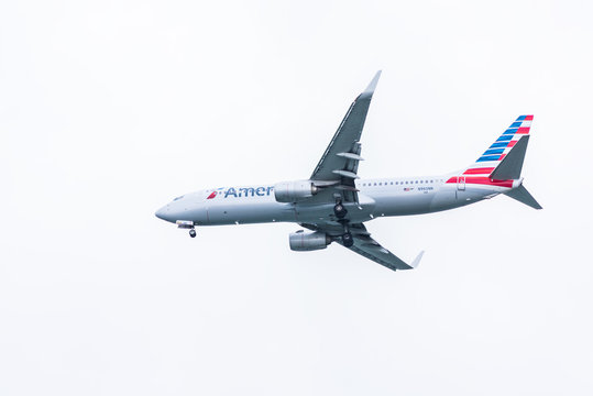 Washington DC, USA - March 17, 2017: Isolated closeup of American Airlines plane landing with cloudy sky