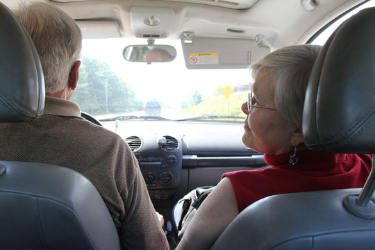 Man driving car with woman in passenger seat