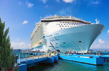 SAN JUAN, PUERTO RICO - MARCH 28, 2019: Cruise ship Royal Caribbean Allure of the Seas docked at port San Juan. The tourist region is a popular Caribbean cruise destination