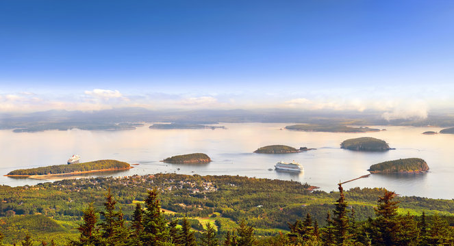 Panoramic view of Bar Harbor in the morning with cruise ships and cluster of small islands from Cadillac Mountain in Acadia National Park, Maine USA