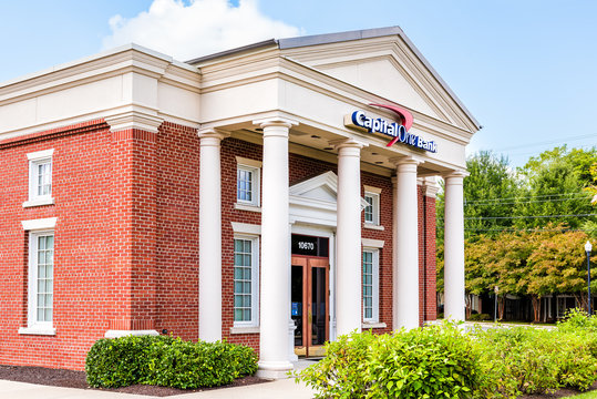 Fairfax, USA - September 15, 2017: Capital One bank branch entrance with sign and columns in old town in Northern Virginia with brick facade
