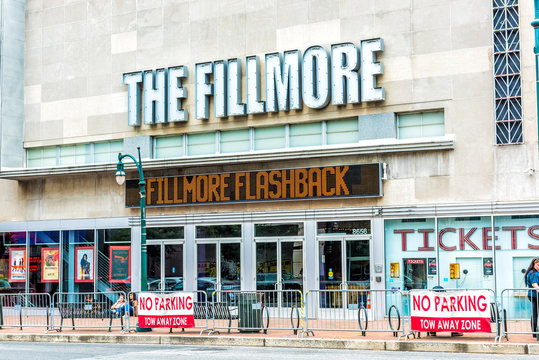 Silver Spring, USA - September 16, 2017: Downtown area of city in Maryland with street road, people and Fillmore movie theater