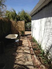 clawfoot iron bath tub outside in garden