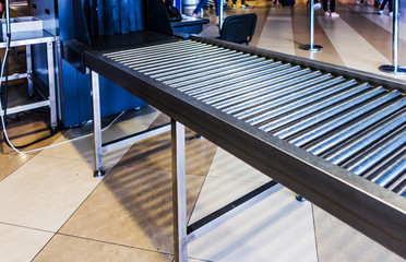 airport police scanner x-ray conveyor belt with passenger luggage bag