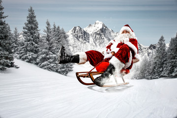 Red Santa Claus riding a wooden sled. An older man with a beard delivers presents to a child....