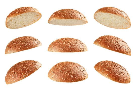 Burger bun tops flying on white background