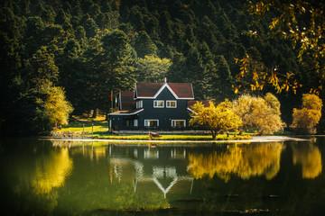 Golcuk National Park Bolu Turkey. Autumn wooden Lake house inside forest in Bolu Golcuk National Park, Turkey wallpaper