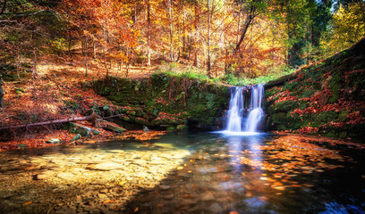 Beautiful waterfall at the mountain in autumn landscape
