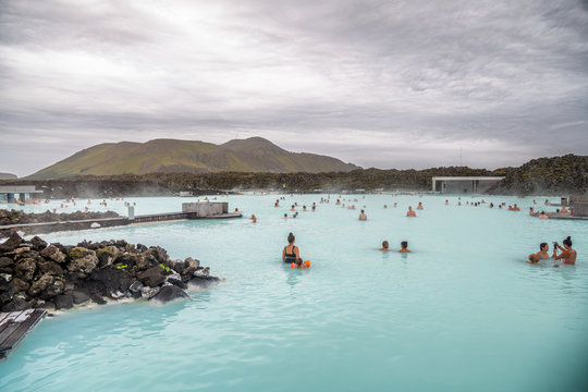 BLUE LAGOON, ICELAND - JULY 31, 2019: Tourists and locals enjoy hot water of natural pools in famous Blue Lagoon